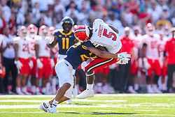 Sep 4, 2021; College Park, Maryland, USA; Maryland Terrapins wide receiver Rakim Jarrett (5) catches a pass and gets hit by West Virginia Mountaineers safety Sean Mahone (29) during the first quarter against the West Virginia Mountaineers at Capital One Field at Maryland Stadium. Mandatory Credit: Ben Queen-USA TODAY Sports