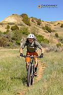 Mountain biking on the Maah Daah Hey Trail near Bear Creek in the Little Missouri National Grasslands, North Dakota, USA MR