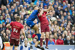 October 7, 2017 - Dublin, Ireland - Adam Byrne of Leinster and Chris Farrell of Munster jump for the ball during the warm-up during the Guinness PRO14 match between Leinster Rugby and Munster Rugby at Aviva Stadium in Dublin, Ieland on October 7, 2017  (Credit Image: © Andrew Surma/NurPhoto via ZUMA Press)