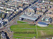 Nederland, Noord-Holland, Amsterdam; 23-03-2020; een zo goed als verlaten Museumplein, geen drommen toeristen of dagjesmensen. Rijksmuseum, Van Goghmuseum, Stedelijk Museum, Concertgebouw zijn gesloten.<br /> Het publieke leven in het centrum van de hoofdstad is bijna geheel stil komen te liggen als gevolg van het Corona virus. Niet alleen is alle horeca dicht, ook veel winkels en andere bedrijven zijn gesloten. Het publiek blijft over het algemeen binnen, de straten en pleinen zijn stil.<br /> A virtually deserted Museumplein, Museum square. No crowds of tourists or day trippers. Rijksmuseum, Van Goghmuseum, Stedelijk Museum, Concertgebouw are closed.<br /> Public life in the center of the capital has come to a complete standstill as a result of the Corona virus. Not only are all pubs, coffee shops and restaurants,  closed, many shops and other companies are also closed. The public generally stays inside, the streets and squares are very quiet.<br /> <br /> luchtfoto (toeslag op standaard tarieven);<br /> aerial photo (additional fee required)<br /> copyright © 2020 foto/photo Siebe Swart