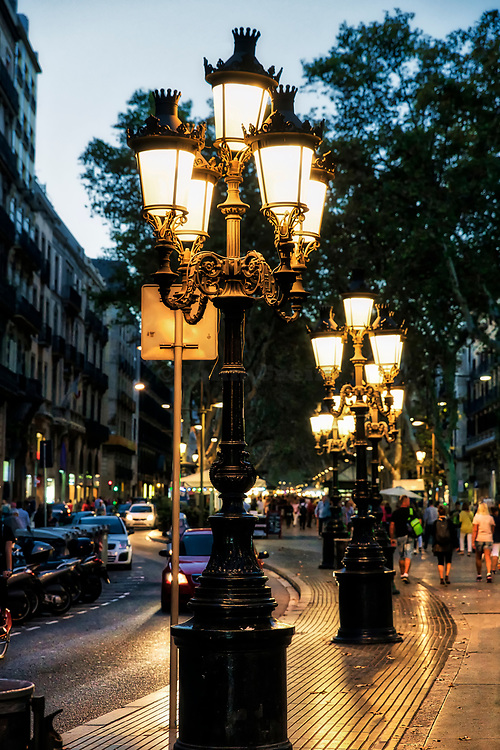 Ornate street lamps adorn Las Ramblas pedestrian street, Barcelona, Spain.