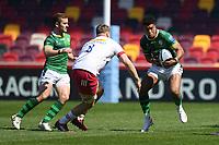 Rugby Union - 2020 / 2021 Gallagher Premiership - Round 17 - London Irish vs Harlequins - Brentford Community Stadium<br /> <br /> London Irish's Ben Loader evades the tackle of Harlequins' Alex Dombrandt.<br /> <br /> COLORSPORT