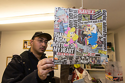 © licensed to London News Pictures. London, UK 24/10/2012. A spectator looking at an artwork which made of newspaper cuttings at 'Jimmy Savile is innocent' exhibition at Bread and Butter Gallery in Islington. Photo credit: Tolga Akmen/LNP