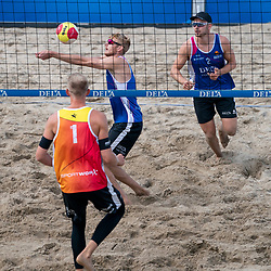 Jasper Bouter L and Ruben Penninga in action. The Final Day of the DELA NK Beach volleyball for men and women will be played in The Hague Beach Stadium on the beach of Scheveningen on 23 July 2020 in Zaandam.