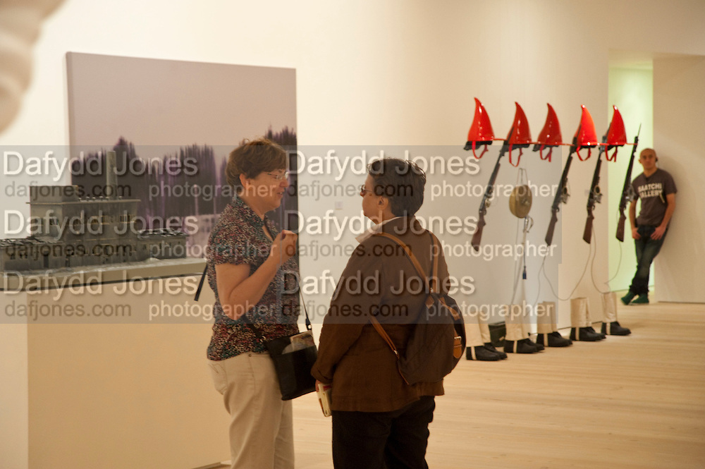 Gallerygoers viewing the Indonesian Eye Contemporary Art Exhibition, Saatchi Gallery. London. Saturday 10 September 2011. <br /> <br />  , -DO NOT ARCHIVE-© Copyright Photograph by Dafydd Jones. 248 Clapham Rd. London SW9 0PZ. Tel 0207 820 0771. www.dafjones.com.