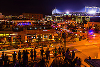 Crowded rooftop bar at LoDo'S Bar and Grill with Coors Field (Colorado Rockies Baseball) in background, LoDo, Downtown Denver, Colorado USA.