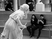 Nydia, the Blind Flower Girl of Pompeii (1859) by sculptor Randolph Rogers tries to get some attention at the Metropolitan Museum