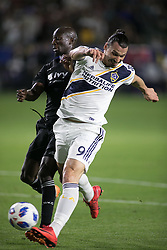 April 8, 2018 - Carson, California, U.S - Zlatan Ibrahimovic #9 of the LA Galaxy battles for the ball with Ike Opara #3 of the Sporting Kansas City during their MLS game on Sunday April 8, 2018 at the StubHub Center in Carson, California. LA Galaxy loses to Sporting, 2-0. (Credit Image: © Prensa Internacional via ZUMA Wire)
