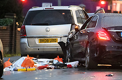 © Licensed to London News Pictures. 11/10/2018. London, UK.  A body and personal belongings lie next to a car at the scene in Hayes where a man was found shot dead after the Mercedes car he was in collided with other vehicles near the Uxbridge Road in Hayes. The victim died at the scene.  Photo credit: Ben Cawthra/LNP