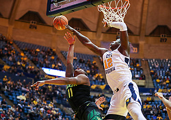 Jan 21, 2019; Morgantown, WV, USA; West Virginia Mountaineers forward Andrew Gordon (12) blocks a shot from Baylor Bears guard Mark Vital (11) during the first half at WVU Coliseum. Mandatory Credit: Ben Queen-USA TODAY Sports