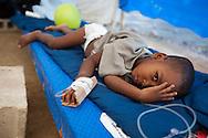 Young boy receiving treatment at a cholera treatment clinic run by Samaritan's Purse in Cabaret. Samaritan's Purse clinic in Cabaret has 80 beds.