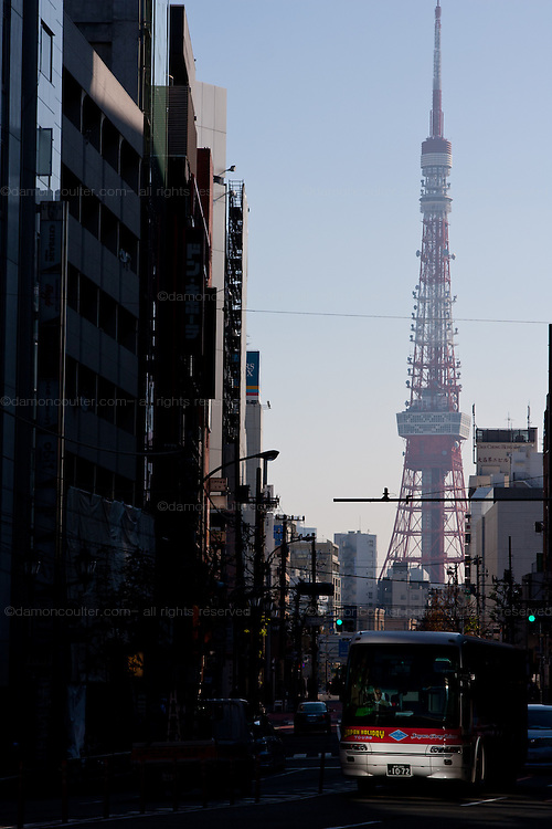 Tokyo Tower. above a street with a city bus. Tokyo, Japan. Wednesday, December 2nd 2009