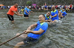 August 29, 2017  Xuan'en, Hubei, China - Contestants compete in a tug of war at the wetland park of Gongshui River in Xuan'en County. (Credit Image: © Song Wen/Xinhua via ZUMA Wire)