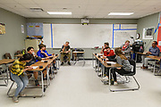 Before round three, teams Beaumont, left, and Hancock, right, and scorekeeper Stayc DuBravac, center, wait for moderator Nick Conder to return to begin the match of Quiz Bowl.<br /> <br /> Teams compete in the preliminary rounds of the 2019 Kentucky Quiz Bowl Alliance Middle School State championship Saturday, April 27, 2019, at Noe Middle School in Louisville, Ky. (Photo by Brian Bohannon)