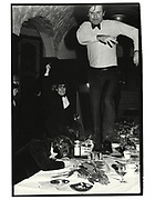Members of the onaninists dining club racing down the table. Oxford Union. Oxford. 1981