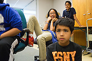 Kimberly Duong, 10, center, laughs with classmates during the International Printing Museum's Ben Franklin's Colonial Assembly: A Museum On Wheels at Curtner Elementary School in Milpitas, California, on May 13, 2014. (Stan Olszewski/SOSKIphoto)