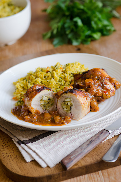 Stuffed chicken thighs in an aromatic spiced tagine sauce with carrot pilau rice