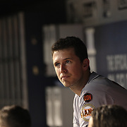 Buster Posey, San Francisco Giants, in the dugout during the New York Mets Vs San Francisco Giants MLB regular season baseball game at Citi Field, Queens, New York. USA. 11th June 2015. Photo Tim Clayton