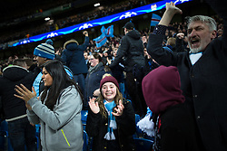 © Licensed to London News Pictures . 08/12/2015 . Manchester , UK . Manchester City fans watching Manchester City vs Borussia Monchengladbach in the UEFA Champions League at the Etihad Stadium . Photo credit : Joel Goodman/LNP