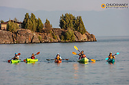Family sea kayaking on Flathead Lake in Somers, Montana, USA  MR
