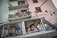 Gori residents survey the bombed apartment buildings. Gori. August 09, 2008