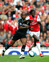 Photo: Tom Dulat.<br /> Arsenal v Bolton Wanderers. The FA Barclays Premiership. 20/10/2007.<br /> Abdoulaye Meite of Bolton Wanderers and Emmanuel Adebayor of Arsenal with the ball.