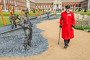 Veterans and Chelsea Pensioners take an emotional look at The D-Day 75 Garden by John Everiss Design - Press preview day at The RHS Chelsea Flower Show.