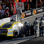 Sprint Cup Series driver Travis Kvapil (38) comes down pit road during the Daytona 500 at Daytona International Speedway on February 20, 2011 in Daytona Beach, Florida. (AP Photo/Alex Menendez)