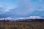 Alpenglow on mountains of The Alaska Range, fall, Denali National Park, Alaska