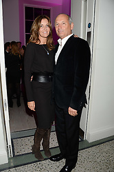 RON DENNIS and CAROL WEATHERALL at a party to launch the Autumn/Winter 2013 Candy Magazine held at The Saatchi Gallery, Duke of York's HQ, King's Road, London on 15th October 2013.