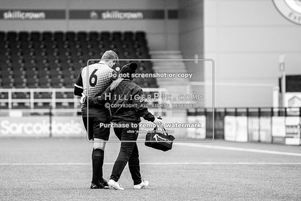 BROMLEY, UK - NOVEMBER 02: Tom Phipps, of Cray Wanderers FC,  is led off injured by Ally Maloney, Physio of Cray Wanderers FC, during the BetVictor Isthmian Premier League match between Cray Wanderers and Worthing at Hayes Lane on November 2, 2019 in Bromley, UK. <br /> (Photo: Jon Hilliger)