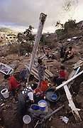 Central America, Honduras, Tegucigalpa. Makeshift amenities near city. Devastation in the aftermath of Hurricane Mitch. High winds and flooding. Refugees. Homes and Infrastructure destroyed.