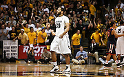 SHOT 1/21/12 5:24:02 PM - Colorado's Carlon Brown #30 reacts after a teammate scores against Arizona during their PAC 12 regular season men's basketball game at the Coors Events Center in Boulder, Co. Colorado won the game 64-63..(Photo by Marc Piscotty / © 2012)