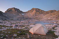 Alpenglow over backcountry camp in Indian Basin, Fremont and Jackson Peaks are in the distance, Bridger Wilderness,  Wind River Range Wyoming