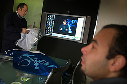 Members of Sketch advertising company put together a public relations package for Islamic televangelist Amr Khaled before his trip to Mecca to preach at the Hajj, Cairo, Egypt, Dec. 28, 2005. Khaled, had previously been asked to leave Egypt as his revival gained strength. As a result he started preaching on several television shows, turning him into an international celebrity. Some religious scholars complain that Khaled has not been properly trained in Islam to command such a following.