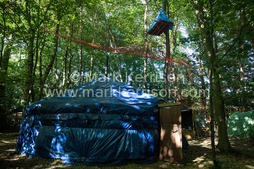 Wendover, UK. 17 July, 2020. A tree platform, net, yurt and tents at Wendover Active Resistance Camp. Environmental activists from groups including Stop HS2 and HS2 Rebellion continue to protest against HS2, which is currently projected to cost £106bn and which will remain a net contributor to CO2 emissions during its projected 120-year lifespan, primarily on environmental and economic grounds.