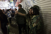 Two young Japanese women dressed as soldiers take a selfie during the Halloween celebrations in Shibuya, Tokyo, Japan. Wednesday October 31st 2018 .  Halloween has grown massively popular  in Japan over the last few yers. Primarily an event for young adults who use it as a chance to dress up in inventive costumes and spend the night partying . In recent years the misbehaviour of some revellers has caused a heavier police presence on the street and  a push back from the Japanese society, and media  who see no need for nor benefits to this western cultural import.