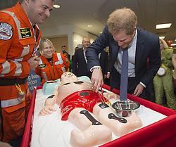 December 7, 2016 - London, GREAT BRITAIN - Britain's Prince Harry, right, plays the ''Operation'' game with members of the London Air Ambulance, during an ICAP Charity Trading Day in support of Sentebale - a charity supporting orphans and vulnerable children, in London, Wednesday, Dec. 7, 2016. (Credit Image: © Prensa Internacional via ZUMA Wire)
