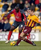 Photo: Jed Wee.<br />Bradford City v Swansea City. Coca Cola League 1. 14/01/2006.<br />Swansea's Adebayo Akinfenwa (L) is tackled by Bradford's Darren Holloway.