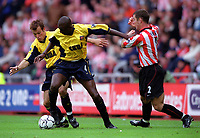 Patrick Vieira and Fredrik Ljungberg (Arsenal) challenged by Chris Makin (Sunderland). Sunderland 1:0 Arsenal. FA Premiership,19/8/2000. Credit Colorsport / Stuart MacFarlane.