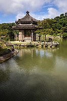 56.1 Shikina-en 識名園  Connected to Shuri Castle is the unique Shikina-en Garden which combines elements of Japanese, Chinese and Okinawan influences.  <br /> It was built at the end of the 18th century as a second home for the royal family of the Ryukyus and to entertain VIP guests.  Its restoration took more than 20 years.  The garden's focal point is a hexagonal pavilion.  Designed as a strolling garden, it is meant to be walked around rather than viewed from one particular angle. The garden incorporates both Japanese and Chinese elements of gardening combined with tropical plants, making it uniquely Okinawan.