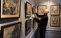 © Licensed to London News Pictures. 07/11/2011. London, UK. David McCabe, the exhibition designer, hangs prints Original prints from Hogarth's 'A Rakes Progress' . The restoration project at Hogarth's House, built in 1750, in Chiswick, West London is completed today 7th November 2011. The house, once Hogarth's residence holds a collection of the artist's 18th century prints and engraving plates. The house suffered damage from a major fire during the restoration. Photo credit : Stephen Simpson/LNP