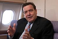 20 NOV 2003, LUFTRAUM:<br /> Gerhard Schroeder, SPD, Bundeskanzler, waehrend einem Interview in einem Airbus 310 der Flugbereitschaft der Bundesluftwaffe, im Luftraum zwischen Deutschland und den USA<br /> IMAGE: 20031120-01-019<br /> KEYWORDS: Gerhard Schröder
