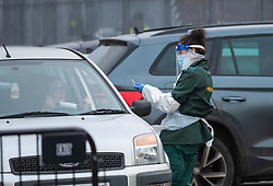 © Licensed to London News Pictures; 02/12/2020; Bristol, UK. NHS testing people in cars for Covid-19 at Bristol City FC's Ashton Gate stadium during the Covid-19 coronavirus pandemic lockdown in England. It is reported that the nearby Concourse at Ashton Gate is being prepared to be one of the regional vaccination centres with logistical support from the army, as the UK becomes the first country in the world to approve the Pfizer/BioNTech vaccine for widespread use to combat Covid-19. Photo credit: Simon Chapman/LNP.