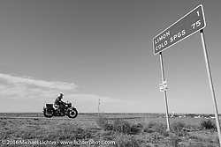 """Doug Jones riding his 1929 Indian 101 Scout into Limon, CO as he passes the """"MCR Half way to Tacoma"""" sign during Stage 9 (249 miles) of the Motorcycle Cannonball Cross-Country Endurance Run, which on this day ran from Burlington to Golden, CO., USA. Sunday, September 14, 2014.  Photography ©2014 Michael Lichter."""
