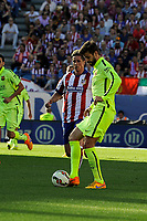 Atletico de Madrid´s Fernando Torres and FC Barcelona´s Gerard Pique during 2014-15 La Liga match between Atletico de Madrid and FC Barcelona at Vicente Calderon stadium in Madrid, Spain. May 17, 2015. (ALTERPHOTOS/Luis Fernandez)