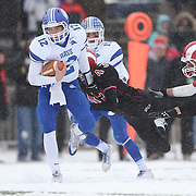 Quarterback Silas Wyper, Darien, rushes for a touchdown  past Sterling O'Hara and Sterling Guynn, (right), New Canaan, during the New Canaan Rams Vs Darien Blue Wave, CIAC Football Championship Class L Final at Boyle Stadium, Stamford. The New Canaan Rams won the match in snowy conditions 44-12. Stamford,  Connecticut, USA. 14th December 2013. Photo Tim Clayton