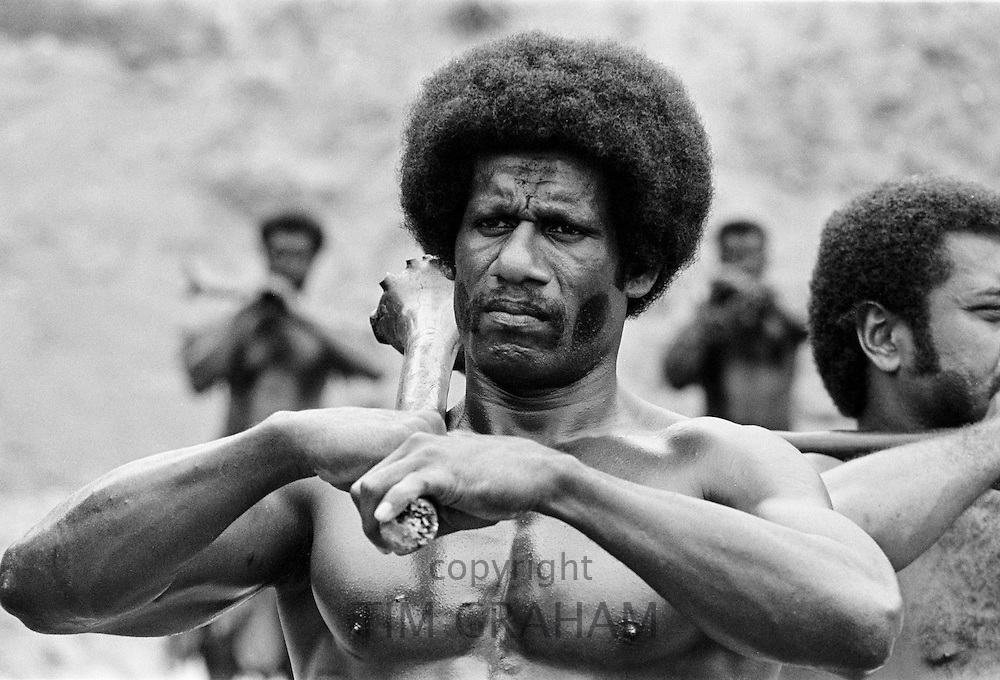 Fijian man taking part in traditional native kava ceremony at tribal gathering in Fiji, South Pacific