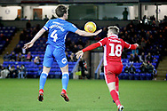 Peterborough Utd midfielder Alex Woodyard (4) handles the ball under close attention from Scunthorpe Utd forward George Thomas (18) during the EFL Sky Bet League 1 match between Peterborough United and Scunthorpe United at London Road, Peterborough, England on 1 January 2019.