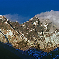 Clouds wreath the Lhotse Nuptse wall in from of Mount Everest (back) in the Khumbu region of Nepal's Himalaya.